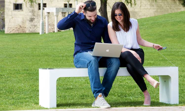 couple sitting on smart bench
