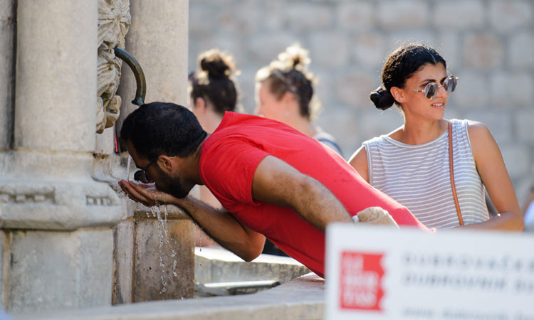 drinking water from public founatin in dubrovnik