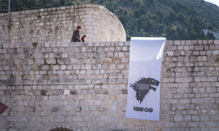 game of thrones banner on dubrovnik walls