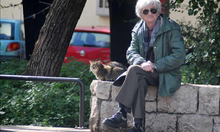sitting with cat in dubrovnik 2018