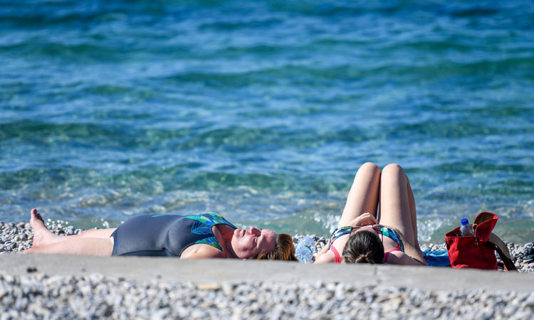 sunbathing on sunset beach dubrovnik in october