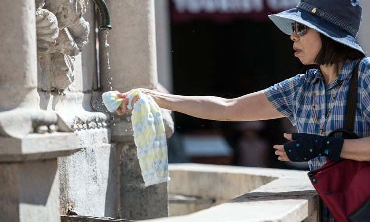 wash face with water in dubrovnik summer 2019