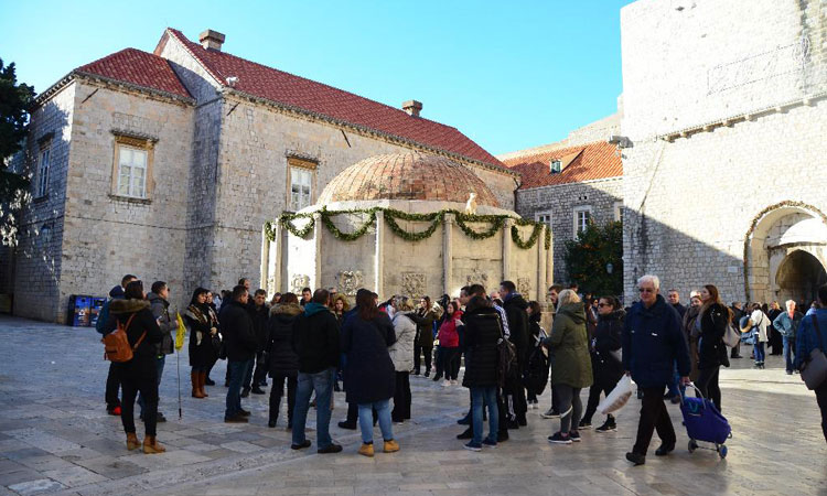 winter tourists around onofrios fountain dubrovnik