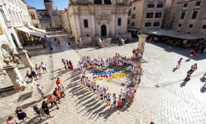 Young tennis players form a heart in Dubrovnik