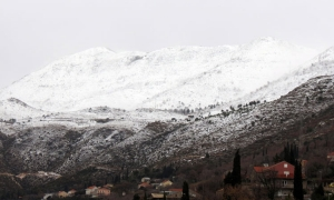 Snow over the hills as temperatures drop
