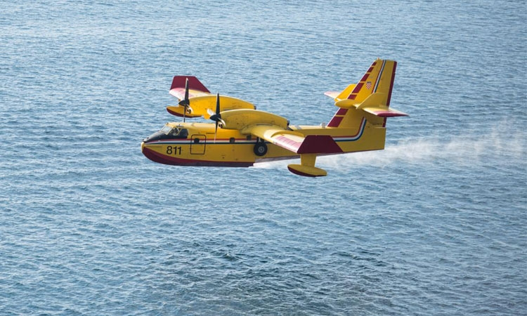 Two fire fighting planes in action near Dubrovnik