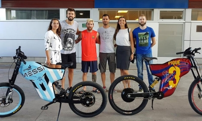 Messi and Pique with the electric bikes