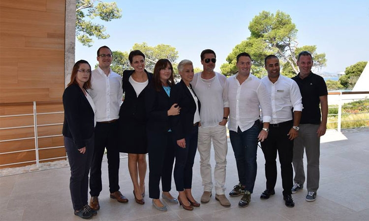 Brad Pitt with members of staff from D-Resort