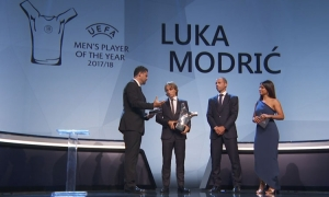 Modric accepts the award