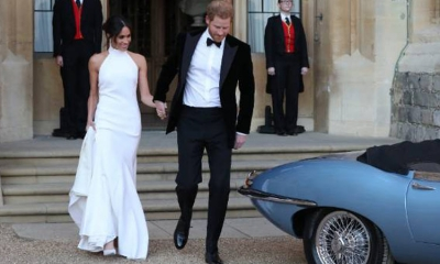 The Royal newlyweds take the Jag for a spin