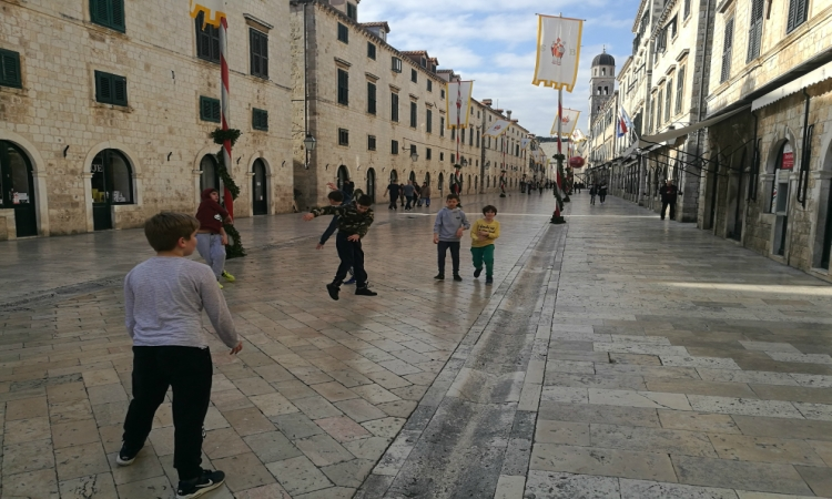 UNUSUAL SIGHT - Boys play handball in the heart of the Old City