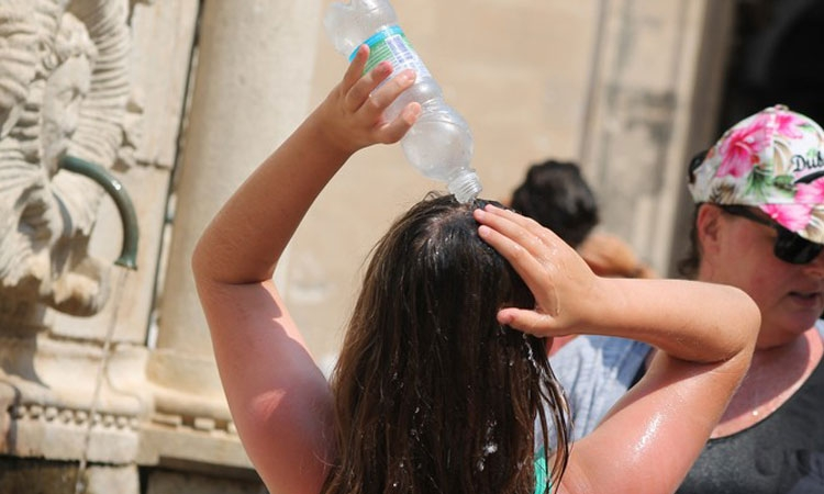 Public shower as temperatures soar