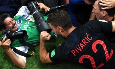 World Cup photographer to tour Croatia after being crushed by players in semi-finals