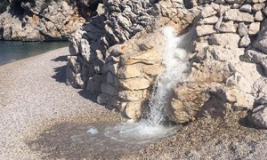 Waterfall onto beach